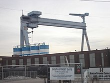 A large crane sits over an empty shipyard