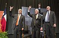 Gregory Fenves, Rex Tillerson and Will Inboden hold up the Hook 'em Horns sign at the University of Texas - 2018 (39132421465).jpg