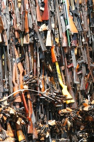 Arms trafficking - A tower of confiscated smuggled weapons about to be set ablaze in Nairobi, Kenya
