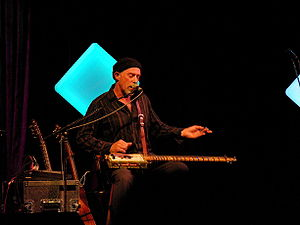 "Harry Manx - Manx playing his self-constructed ""cigar box guitar"""