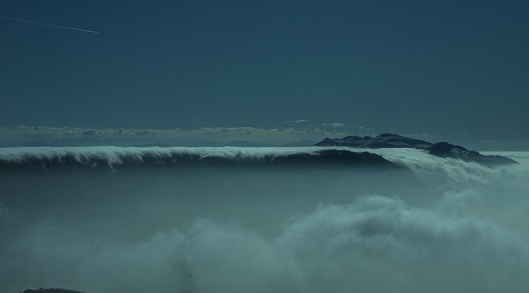 Haute Chaîne du Jura, from the Crêt de Chalam, Ain. The clouds seem to fall down into a cascade.