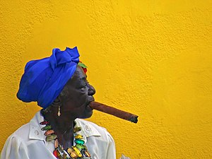 Habanos S.A. - A woman smoking a cigar in Old Havana