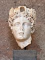 Head of Tyche (1st cent. A.D.) at the Archaeological Museum of Ancient Corinth on 3 June 2018.jpg