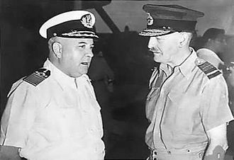 Scrambled egg (uniform) - Dutch Admiral Helfrich with British Air Marshal Brooke-Popham both wearing peaked caps with embellishments