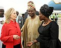 Hillary Rodham Clinton greeted by Olugbenga Ashiru and Viola Onwuliri in Nigeria August 9 , 2012.jpg