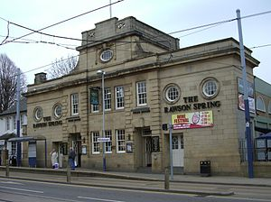 Hillsborough, Sheffield - The Rawson Spring pub formerly Hillsborough baths with Hillsborough Supertram stop in front.