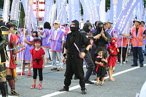 Three people in black costumes