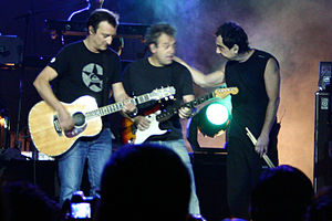 Hombres G - Dani Mezquita (left), Rafa Gutierrez (middle), and Javi Molina (right) perform on stage in 2009.
