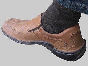 jason is sporting his new hush puppies.
