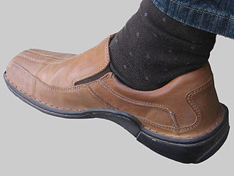 Hush Puppies - A Hush Puppies shoe on a man's foot