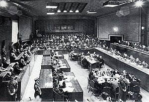 International Military Tribunal for the Far East - View of the Tribunal in session: the bench of judges is on the right, the defendants on the left, and the prosecutors in the back.
