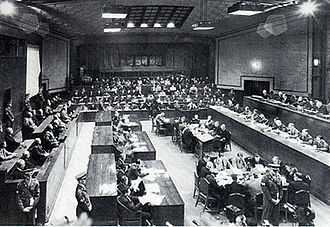 International Military Tribunal for the Far East - View of the Tribunal in session: the bench of judges is on the right, the defendants on the left, and the prosecutors in the back