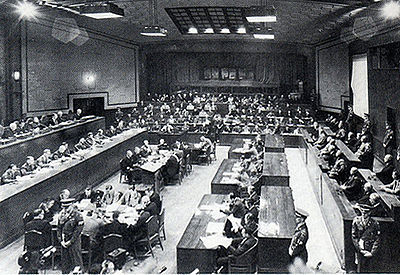 Wide view of the Tribunal, depicting the bench of judges on the left, defendants on the right, and prosecutors in the back.