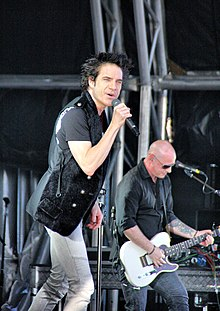 Pat Monahan and Jimmy Stafford of Train performing in January 2011