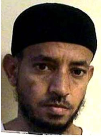 """Omar Said Salim Al Dayi - Official Guantanamo identity portrait of Omar Said Salem Adayn, showing him wearing the white uniform issued to """"compliant"""" individuals."""