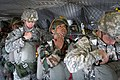 Indian and U.S. paratroopers check their equipment one last time before exiting a CH47 Chinook helicopter during an airborne operation in 2013.jpg