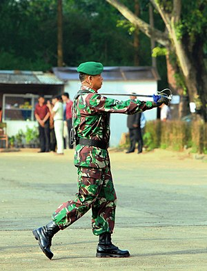 Ceremonial weapon - An Indonesian army officer using a sabre/sword during serving as a ceremonial field commander