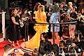 Jennifer Lopez Long Yellow Gown (48749730682).jpg