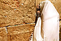 Jew praying at the Western Wall.jpg