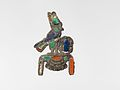 Jewelry element representing a falcon wearing a double crown MET DP-889-11.jpg