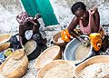 Joal Fadiouth women preparing millet to make couscous flour ....jpg