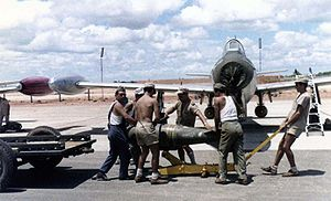 Republic F-84 Thunderjet - A Portuguese F-84 being loaded with ordnance in the 1960s, at Luanda Air Base, during the Portuguese Colonial War.