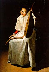 A young lady holding a lute with a music score on her lap in a candlelit interior