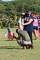 Julie Paxton, a realtor, hammers in rebar for building a flag display for Memorial Day, Asan Beach, Guam, May 25, 2013 130525-M-BC209-055.jpg