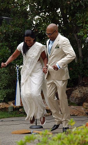 Jumping the broom - A couple jumping the broom (photograph of a 2011 wedding in California)