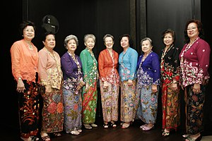 group of women posing in traditional Peranakan nonya kebaya