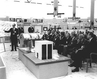 George Mueller (NASA) -  George Mueller gives a briefing to Kennedy six days before his assassination.