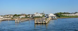 Kismet, New York - The town of Kismet on Fire Island is seen from the Fire Island Ferry on bay side of the island in the early evening during the summer.