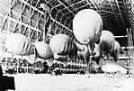 Kite balloons of No. 1 Balloon Training Unit await their handlers, during the morning parade in No. 1 Airship Shed at Cardington, October 1940. CH17332.jpg