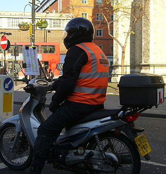 "Taxicabs of the United Kingdom - ""Knowledge boy"" on a Honda Super-Cub."