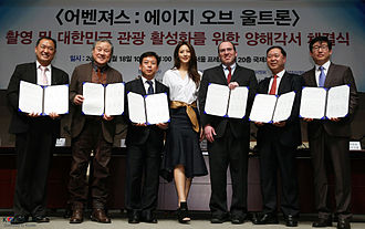 Avengers: Age of Ultron - Members of the Korea Film Commission and executives from Marvel Studios signing a memorandum of understanding in Seoul in March 2014 with actress Claudia Kim (center) in attendance