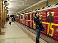Krasnaya strela (Red arrow) train at Krasnoselskaya station (Метропоезд Красная cтрела на станции Красносельская) (5234104505).jpg