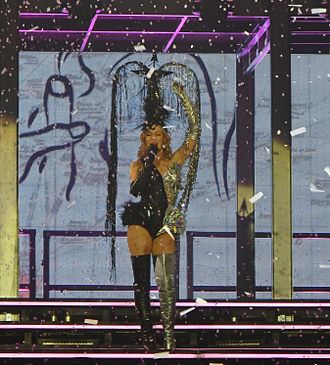 "All the Lovers - Minogue singing ""All the Lovers"", as confetti falls down upon her, during 2014's Kiss Me Once Tour."