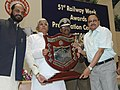 Lalu Prasad presenting the Outstanding Service Award to Railwaymen on the occasion of the 51st Railway Week, in New Delhi on April 10, 2006. The Minister of State for Railways, Shri Naranbhai J. Rathwa is also seen (1).jpg