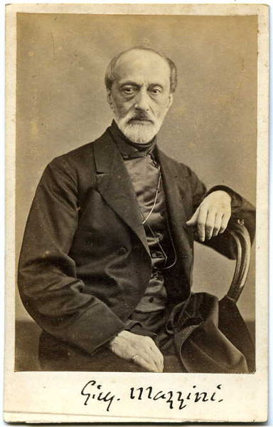 Black and white photographic portrait of Giuseppe Mazzini by Domenico Lama (1823-1890) with G.M.'s signature at the bottom.