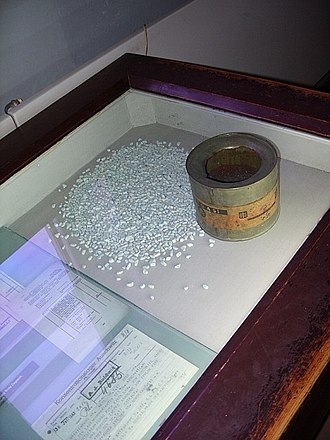 "Zyklon B - A can of Zyklon B with adsorbent granules and original signed documents detailing ordering of Zyklon B as ""materials for Jewish resettlement"" (on display at Auschwitz concentration camp museum)"