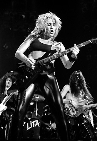 """Lita Ford - Ford performing on 19 December 1988 in the """"Olympiahalle"""" venue of Munich, Germany."""