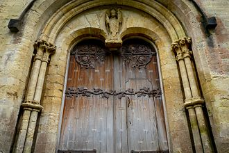 Llandaff Cathedral - The door of the west front of Llandaff Cathedral; a statue of St Teilo is seen above the door.