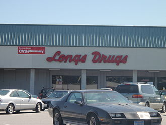 Longs Drugs - Storefront of Longs Drugs in South San Francisco, California, USA. Note sign announcing CVS/pharmacy coming soon.