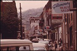 MAIN STREET OF LOGAN, WEST VIRGINIA, SHOWING A NARROW STREET WITH PARKING ON ONLY ONE SIDE WHICH IS TYPICAL IN MANY... - NARA - 556422.jpg