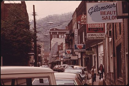 Logan in 1974 MAIN STREET OF LOGAN, WEST VIRGINIA, SHOWING A NARROW STREET WITH PARKING ON ONLY ONE SIDE WHICH IS TYPICAL IN MANY... - NARA - 556422.jpg