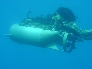 Diver propulsion vehicle - Two U.S. Marines of the Maritime Special Purpose Force operating a Diver Propulsion Device (DPD)