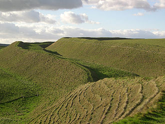 History of England - View of the ramparts of the developed hillfort of Maiden Castle, Dorset, as they look today