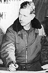 """Major Harry C. Aderholt in fur-collared flight jacket as USAF and Army officers coordinating a """"Special Air Mission"""" with South Korean counterparts during the Korean War in 1951, ARCS Special Air Mission Korea (cropped).jpg"""