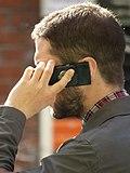 Man speaking on mobile phone.jpg