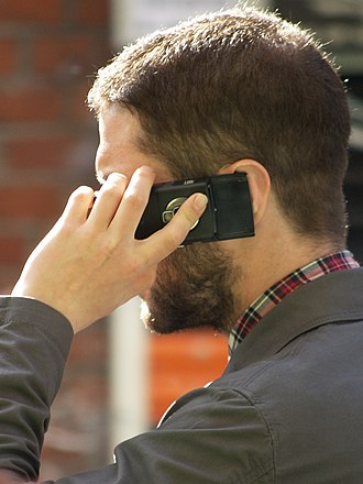 Mobile phone radiation and health - Image: Man speaking on mobile phone